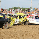 Drivers smash into each other in the 1980's stock class of the 69th annual Lorain County Fair demolition derby Sunday night. ANNA NORRIS/CHRONICLE
