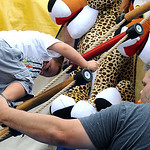 Austin Gillespie, 3, of Elyria, climbs Blackbeard's Ladder with assistance from his father Doug.  STEVE MANHEIM/CHRONICLE