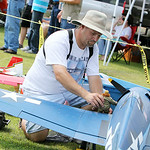 John Dolacki, of Lorain, places a World War I figurine on his World War I F6F-3 radio controlled model airplane during the annual Lorain County Radio Control Club's Model Mania Sunday aftern …