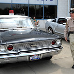 Deputy Barney Fife, played by Todd Beckett of Massillon, with his Ford patrol car, at the Nick Abraham Elyria Ford 6th Annual Mustang and Ford Show, co-hosted by North Coast Mustang Club of  …