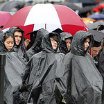 Oberlin College graduates wear ponchos to keep them dry from the rain as they listen to the commencement speech delivered by novelist Tracy Chevalier, Oberlin College 1984 graduate, author o …