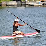 Marilyn DeJesus of Lorain raced in the Black River Kayak-a-thon Saturday morning, but her real prize was a paddleboard, which she won in a raffle for race participants. She wasted no time tr …
