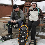 Newlyweds Jennifer and Patrick Cockburn get ready to go on a snow shoe hike at Sandy Ridge Reservation – Johnson Wetland Center in North Ridgeville. photo by Ray Riedel