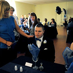 Linda Poprocki-Jake puts her hand on her son, Dominic DeAngelis, before leaving her twins at the prom.  KRISTIN BAUER/CHRONICLE