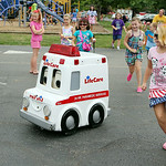 "Children chase after ""Andy the Ambulance"" during St. Jude's annual Parish Festival Sunday afternoon in Elyria. ANNA NORRIS/CHRONICLE"