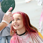St. Jude third grader Caitlin Hansen, 8, gets a look at her new hair color after getting it spray painted multiple colors. ANNA NORRIS/CHRONICLE
