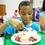 Thomas Charlton, 9, of Elyria, has strawberry shortcake at the Elyria Kiwanis annual Strawberry Festival at St. John Lutheran Church on June 12.   Steve Manheim