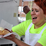 Alice Young of Vermilion serves a cherry cheese boat at the Polish booth operated by Kiedrowski's Simply Delicious Bakery Sunday afternoon at the Lorain International Festival bazaar.