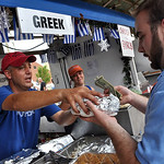 Emmanuel Tsambounigris of Cleveland serves a gyro to Evan Dispenza of Amherst Sunday afternoon at Lorain International Festival.