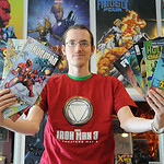 Bryan Branch, owner of Keith's Comics, holds comics to be given away on free comic book day on May 1.  Steve Manheim