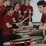 Oberlin College senior John Paddock, a member of the Taiko drumming group at the college, works his way down a series of drums during a performance Sunday at Hales Gym at Oberlin College.    …