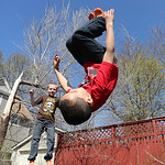 Julien Harris, 6, does a flip while his brother Adrien, 8, jumps in the background. BRUCE BISHOP/CHRONICLE