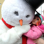 Haley Stepp, 1 1/2, of Vermilion, gives the snowman a hug at the Ice-A-Fair in Vermilion Feb. 5.  The town-wide event featured ice carvings,  carving demonstrations, carraige rides and hot c …