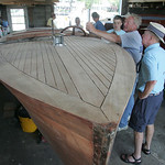 "Tom Moes, co-owner of Moes Marine Service in Vermilion, talks with Bud Long (in hat) of Portage Lakes about the 1927 26-foot Doge Watercar that was built in Detroit, ""There are none of this  …"