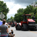 A crowd gathered to watch tractors roll down Route 58 during the annual Cheese Heritage Festival Parade on Saturday. KRISTIN BAUER | CHRONICLE