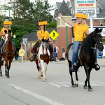 Despite threatening showers, parade participants marched and rode down state Route 58 in Wellington to celebrate the annual festival Saturday. KRISTIN BAUER | CHRONICLE