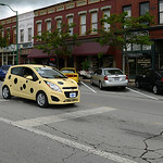 A yellow Chevy Spark, decked out as a piece of cheese, makes it takes part in the parade. KRISTIN BAUER | CHRONICLE