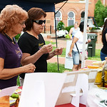 Linda Zanni and Rita Tomsic, both of Elyria, try cheese samples at the Heini's booth.  KRISTIN BAUER | CHRONICLE
