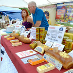 Angela Carpenter and Bill Speicher, both of Wadsworth, set up the American Classic Snack Company and Heini's booths at the Cheese Festival in downtown Wellington on Friday. KRISTIN BAUER | …