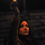 Jennifer Newman, Firelands class of 2011, holds a candle at a vigil for teacher Jim Muth on Nov. 23.   Steve Manheim