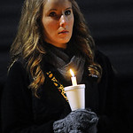 Alie Gillen, Firelands class of 2011, holds a candle at a vigil for teacher Jim Muth on Nov. 23.   Steve Manheim