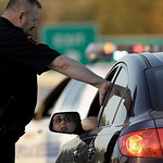 A police officer tells a woman that the base remains closed following a shooting at Fort Hood, Texas, Thursday, Nov. 5, 2009.  (AP Photo/LM Otero)