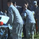 In this image made from Associated Press Television video, emergency personnel take a wounded person on a stretcher to an awaiting ambulance at the scene at the U.S. Army base in Fort Hood T …