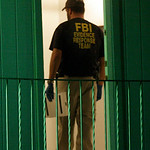 A Federal agent stands in the door of the  the apartment of Maj. Nidal Malik Hasan in Killeen, Texas, early Friday, Nov. 6, 2009. Hasan, an Army psychiatrist set to be shipped overseas opene …