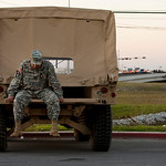 """Sgt. First Class Noe Figueroa waits to get back on base outside Fort Hood's Clear Creek gate in Killeen, Texas on Thursday, Nov. 5, 2009, after a mass shooting on the base. """"I think it's sad …"""