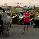 Kris Starr waits outside Fort Hood's Clear Creek gate in Killeen, Texas on Thursday Nov. 5, 2009, after a shooting.  She was waiting with older soldiers to be let back on base to go home. St …