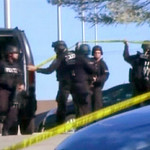 In this image made from Associated Press Television video, police respond at the scene at the U.S. Army base in Fort Hood Texas where a soldier opened fire, unleashing a stream of gunfire th …