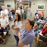 Volunteers waiting in line to donate blood at Scott and White Hospital in Temple, Texas, Thursday Nov. 5, 2009, look up at a television as an announcement is made that a suspected gunman in  …