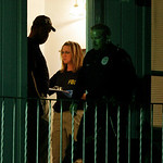Federal agents search the apartment of Maj. Nidal Malik Hasan in Killeen, Texas, early Friday, Nov. 6, 2009. Hasan, an Army psychiatrist set to be shipped overseas opened fire at the Fort Ho …