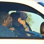 A law enforcement officer, center, rubs his eyes as he and other officers guard the closed front gate at Fort Hood, Texas, after a mass shooting, Thursday, Nov. 5, 2009. (AP Photo/Michael Th …