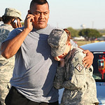 Staff Sgt. Fanuaee Fea, 32, comforts Savannah Green, 23, outside the  main gate after a shooting at Fort Hood, Texas on Thursday, Nov. 5, 2009. (AP Photo/The Waco Tribune-Herald, Jerry Larso …