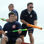 Lorain firefighers squirt the crowd at the at the Lorain International Festival Parade on June 30.  Steve Manheim