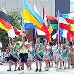 Lorain Girl Scout Troop 5077 carry the flags at the Lorain International Festival Parade on June 30.   Steve Manheim