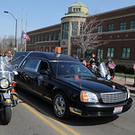 A procession carrying Officer Jim Kerstetter's body passes the Elyria police station.