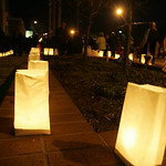 Residents place luminaries along the route Officer Jim Kerstetter's family took home from the funeral home.