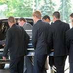 Pallbearers move the casket of Kevin Fox to the hearse after his funeral service at Cornerstone Chapel in Medina on June 9.  Steve Manheim