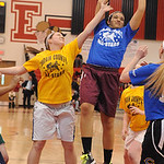 Blue all-star Raven Howard of Wellignton grabs a rebound away from Orange all-star Jessica Eichenlaub of Midivew in Lorain County Girls All-Star Game at Elyria on Mar. 19.   Steve Manheim