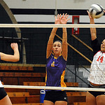 Elyria 14 Kayla Young and Olivia Boccabella of Avon defend against Vermilion 14 Mallory Morris in game 1 of Lorain County All Star volleball on Nov. 14.   Steve Manheim