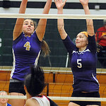 Andrea Dillon 4 of Vermilion, and Sarah Hasel 5 of Keystone defend against Elyria 14  Kayla Young in first game of Lorain County Volleyball All Stars at Elyria Catholic on Nov. 14.  Steve Ma …