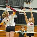 Emily Mandoke 30 of Elyria defends agaisnt Avon Lake Isabelle Wagner in game 2 of Lorain County All Star volleball on Nov. 14.   Steve Manheim
