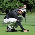 Kevin Koepp of Elyria lines up a putt the Lorain County Coaches tournament at Columbia Hills on Sep. 19.   Steve Manheim