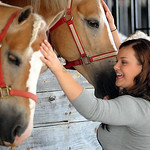 Camille Cremean, of Sandusky, pets the horses at Lorain County Fair on Aug. 21.  Steve Manheim