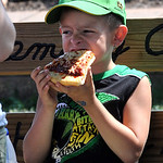 Aaron Daniels, 7, of Wellington, has a pizza slice at Lorain County Fair on Aug. 23.  Steve  Manheim
