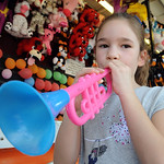 Sophia Palmison, 6, of Wellington, won a horn in the dart toss game at Lorain County Fair on Aug. 23.   Steve manheim