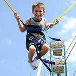 Trynter Stiles, 5, of Wellington, has fun on the bungee trampoline at Lorain County Fair on Aug. 23.  Steve Manheim