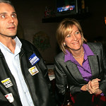 Betty Sutton visits Diso's Bistro in Lorain and peeks at the incoming election results along with Lorain County Commissioner Ted Kalo.    photo by Chuck Humel